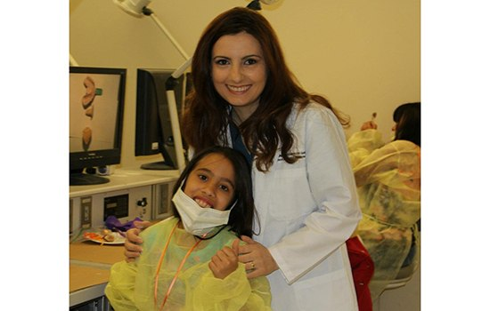 dentist with young girl patient