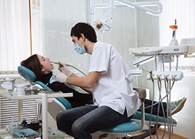 Woman in dental chair for full mouth reconstruction.