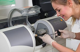 Dental assistant using CEREC milling unit