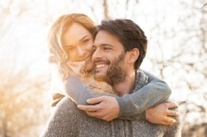 couple smiling in cold
