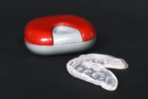 a grinding mouthguard and its storage case